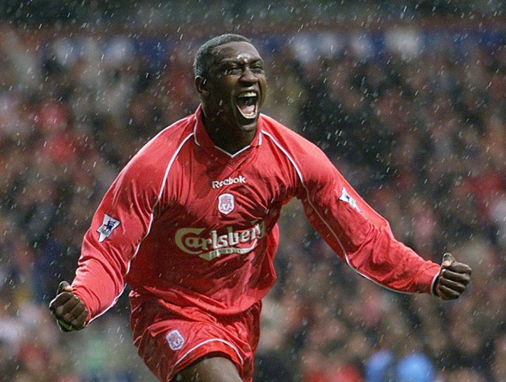 BIR04-20010408-LONDON, UNITED KINGDOM: Liverpool striker Emile Heskey celebrates in the pouring rain after scoring his team's first goal against  Wycombe Wanderers 08 April 2001, during their F.A. Cup semi-final match at Villa Park, Birmingham.    EPA PHOTO         EPA/GERRY PENNY